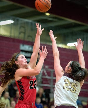 Metamora's Katy Ramage take a shot over a Dunlap defender during a game in the 2019-20 season.