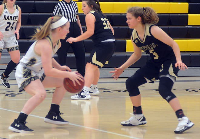 Newton sophomore Piper Seidl looks to drive on Andover Central senior Bailey Willborn during play Friday at the Newton Invitational.
