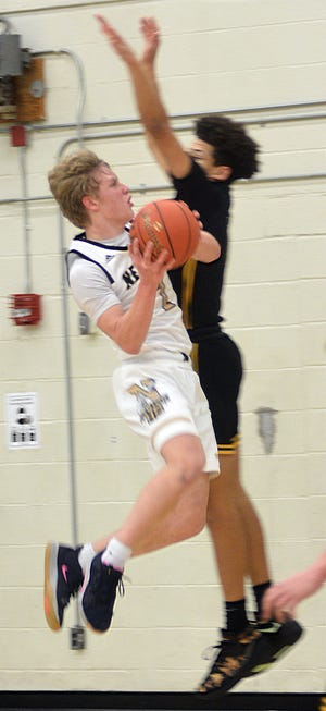 Newton junior Dylan Petz goes to the basket during play Friday against Salina South. Newton plays Tuesday at Maize.