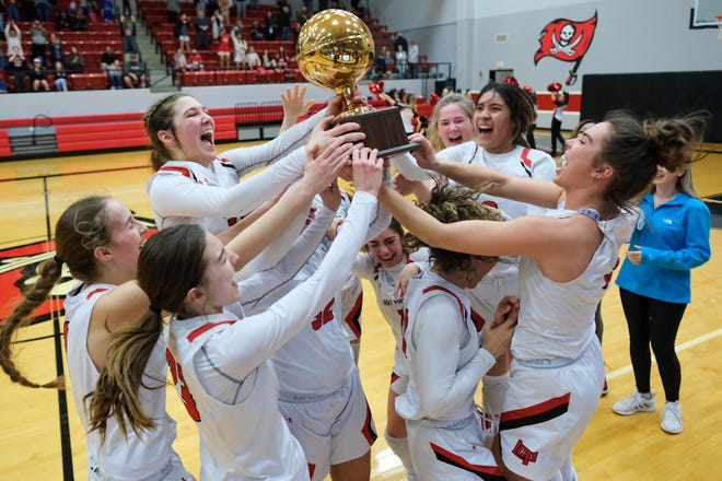 The Lubbock-Cooper girls basketball team celebrates a 60-45 win over Abilene Wylie which helped clinch the District 4-5A title Friday, Jan. 29, 2021 in Woodrow, Texas. The Lady Pirates also claimed the No. 1 seed in district.