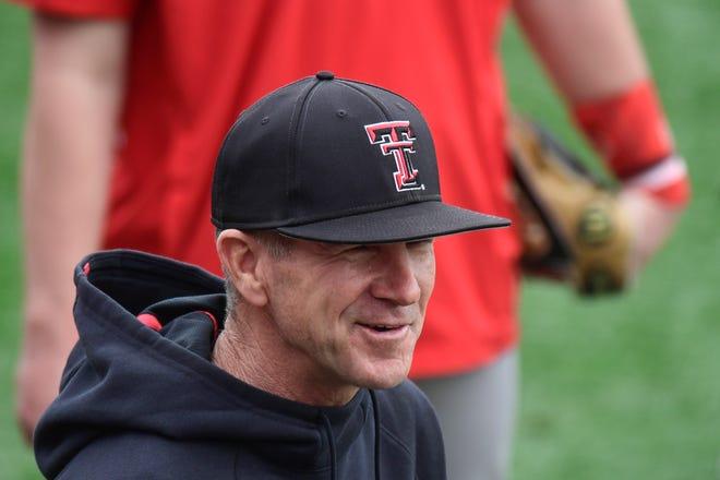 Texas Tech head coach Tim Tadlock talks to players before batting practice on Friday, Jan. 29, 2021, at Dan Law Field in Lubbock, Texas. [Justin Rex/For A-J Media]