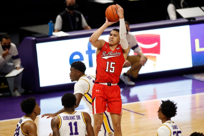 Texas Tech's Kevin McCullar (15) shoots over a pair of LSU players during a Big 12/SEC Challenge game last season in Baton Rouge, Louisiana. The Red Raiders will host Mississippi State in their Big 12/SEC Challenge game this coming season.