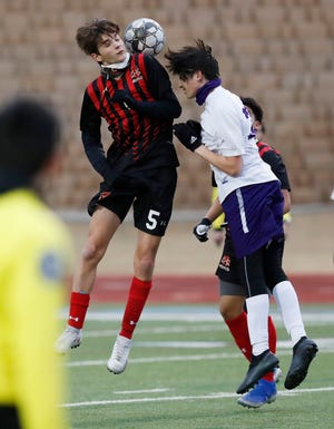 Coronado's Lukas Saldana (5) and Canyon's (21) head the ball next to each other in the first half of their non-conference game between Coronado High School and Canyon High School at Lowrey Field at PlainsCapital Park in Lubbock, TX, Friday Jan. 29, 2020. (Mark Rogers/For A-J Media)