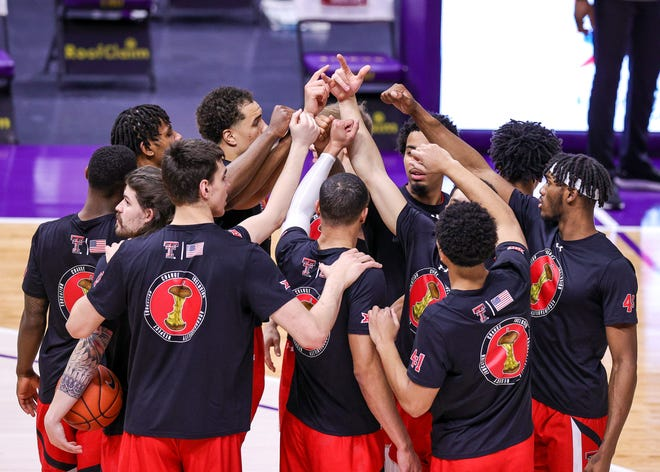 Texas Tech players huddle up prior to a game against LSU on Saturday as part of the SEC/Big 12 Challenge at the Pete Maravich Assembly Center. [Stephen Lew/USA TODAY Sports]