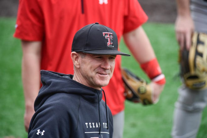 Texas Tech head coach Tim Tadlock talks to players before batting practice Friday at Dan Law Field at Rip Griffin Park. The Red Raiders held their first official practice after their 2020 season was canceled March 12, 2020 due to the COVID-19 pandemic.