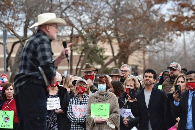 Rusty Thomas, director of Operation Save America, speaks from the stage during the March for Life event Friday in Lubbock.