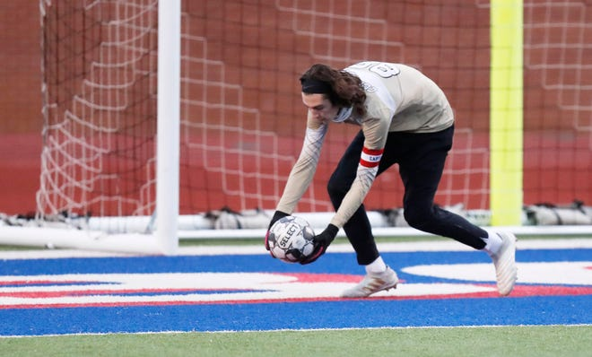 Coronado goalie Devin Samples stops a shot against Canyon High School at Lowrey Field at PlainsCapital Park in Lubbock on Jan. 29.