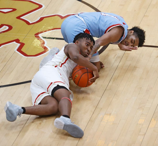 Coronado's Kevon Evans (4) and Monterey's Devin White (1) dive on the loose ball during the game against Monterey, Friday, Jan. 29, 2021, at Coronado High in Lubbock, Texas.