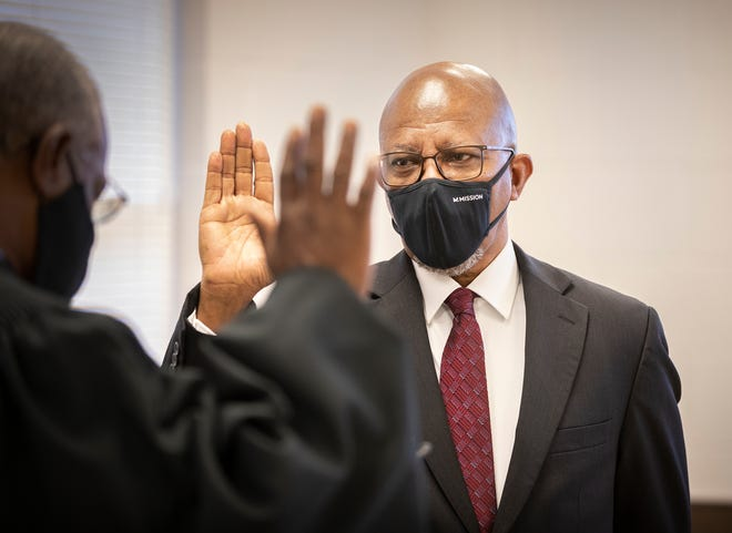 Terry Coney, right, is sworn in as the new president of the Polk County chapter of the NAACP by retired Polk County Judge Timothy Coon, left, during a ceremony at the Coleman Bush Building in Lakeland.