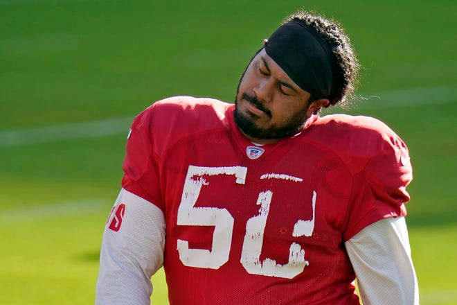 Tampa Bay Buccaneers defensive tackle Vita Vea stretches his neck during training camp in August.