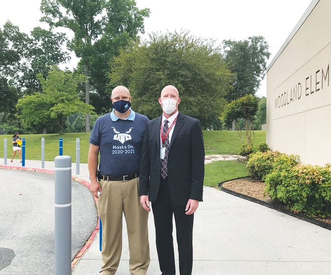 Oak Ridge Schools Superintendent Bruce Borchers, right, and Woodland Elementary School Principal D.T. Hobby stand — masked — outside the school back in late July on the first day of classes for this school year. Leading a school system during a pandemic is one of the tasks Borchers has faced. Last Monday night, the Oak Ridge Board of Education extended his contract another year.