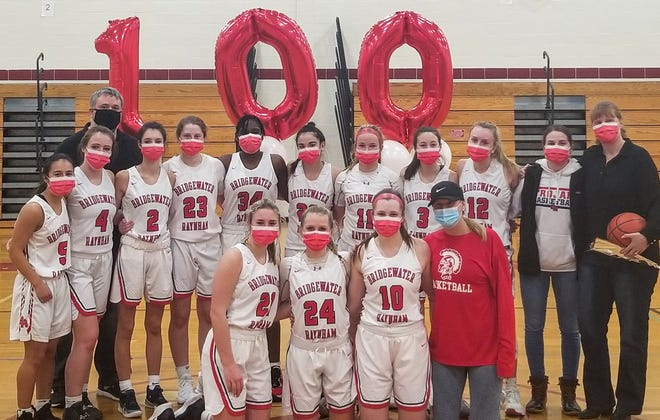Coach Cheryl Seavey, far right, poses with her Bridgewater-Raynham High girls basketball team after recording her 100th career win. The Trojans beat visiting Brockton, 66-42, on Friday, Jan. 29, 2021.