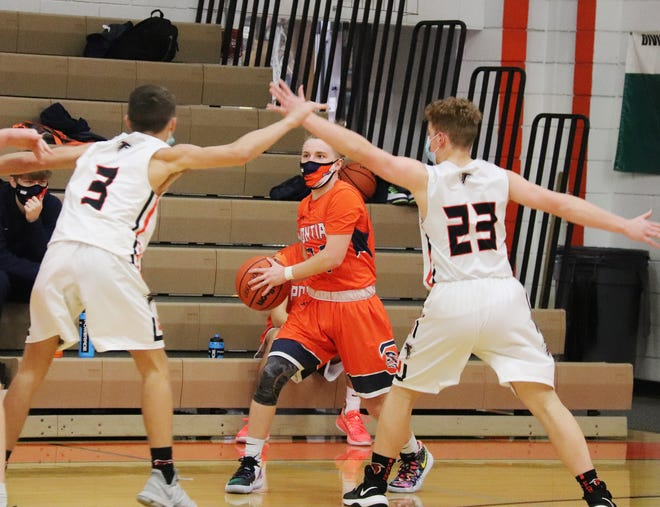 Dallas Hamilton (3) and William Weber (23) pressure Pontiac's Mason Monahan in the backcourt during Saturday's boys' basketball contest in Flanagan. The Falcons defeated PTHS 50-32.