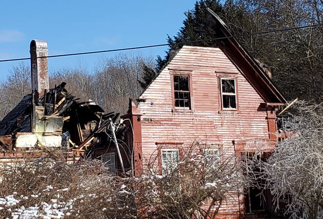 This home at 15 Jack Rabbit Lane in Stratham was destroyed in a fire in the early morning hours Saturday, Jan. 30, 2021. Firefighters from multiple Seacoast communities battled the blaze in the dark and in frigid weather.
