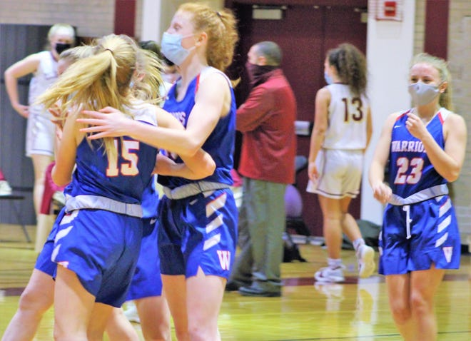 Winnacunnet players celebrate seconds after securing a 52-46 victory over Portsmouth. It was Winnacunnet's first win after losing its opening four games of the season.