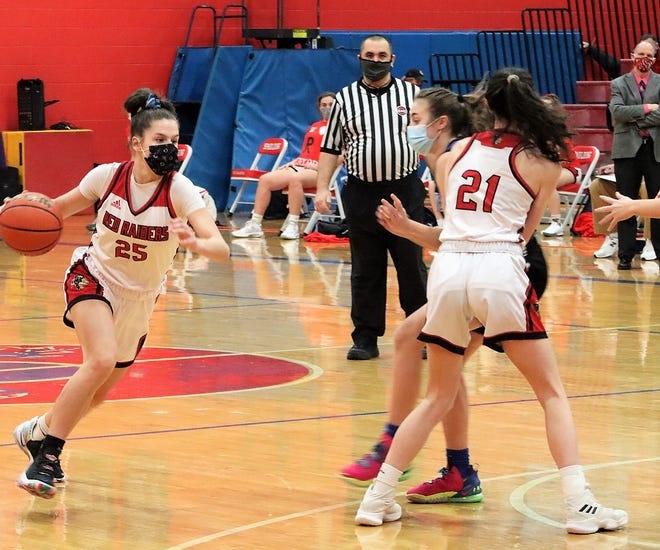 Spaulding's Hannah Drew (25) drives toward the basket with the help of a screen by teammate Ambra Breakfield during Friday's girls basketball game against Oyster River.
