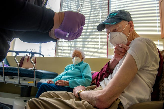 Manfred and Sheila Steiner of Riverside get the first of their COVID vaccinations on Saturday at Lifespan's Center for Primary Care in Providence.