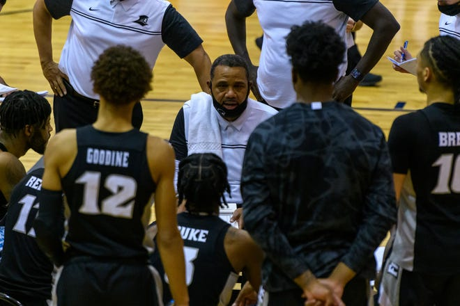 Providence Friars coach Ed Cooley speaks with this team in the first half of Saturday's game at Georgetown, which PC lost, 73-72.