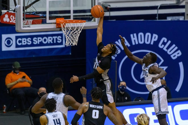 Providence's A.J. Reeves goes in for two of his season-high 28 points in Saturday's game against Georgetown.