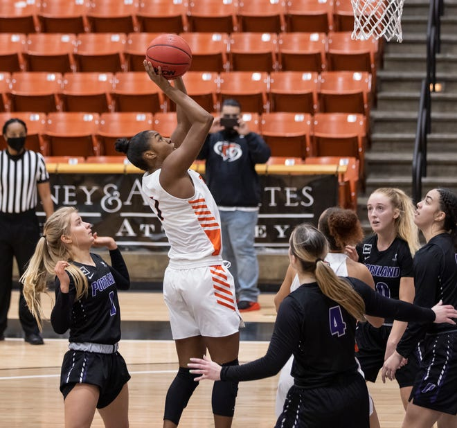 University of the Pacific forward Brooklyn McDavid (1) grabs the rebound and makes a shot during the second quarter during a WCC women's basketball game at Spanos Center in Stockton on Saturday.