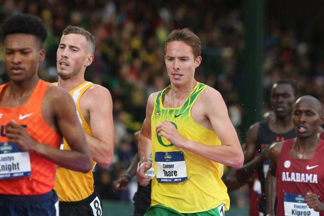 Cooper Teare, right, helped Oregon set another NCAA record in the men's distance medley relay on Friday.