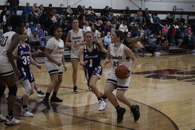 Guard Kyra Stauble (21), pictured against Fletcher on Jan. 29, leads St. Augustine into Tuesday's regional girls basketball semifinal against Ponte Vedra.