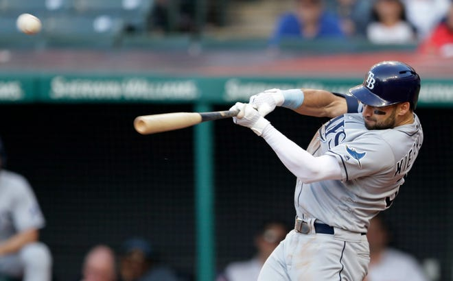 Tampa Bay Rays' Kevin Kiermaier hits a three-run, inside-the-park home run off Cleveland Indians starting pitcher Adam Plutko during the sixth inning of a baseball game, Thursday, May 23, 2019, in Cleveland. (AP Photo/Tony Dejak)