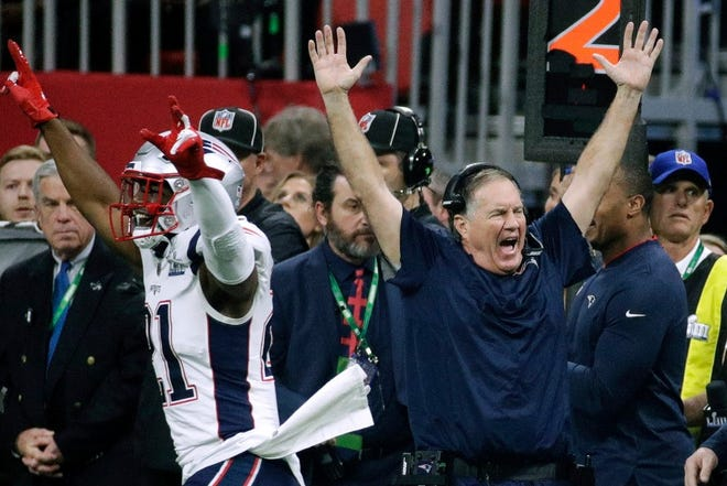 In this Feb. 3, 2019 photo, New England Patriots' Duron Harmon (21) and head coach Bill Belichick celebrate after the Patriots defeated the Los Angeles Rams in the Super Bowl in Atlanta. The 13-3 score was the lowest in Super Bowl history.