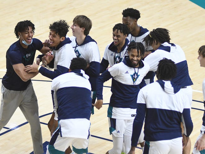 UNCW players in the pregame huddle Saturday, Jan. 30 vs. Hofstra. The Seahawks return to the floor for the first time since Jan. 31 on Saturday against Elon in the season finale.