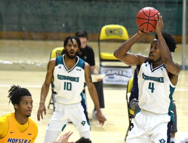 UNCW guard Mike Okauru shoots during Saturday's 82-73 loss to Hofstra at Trask Coliseum. The senior had 21 points, the third time in five conference games he has at least 20 points. [MATT BORN/STARNEWS]