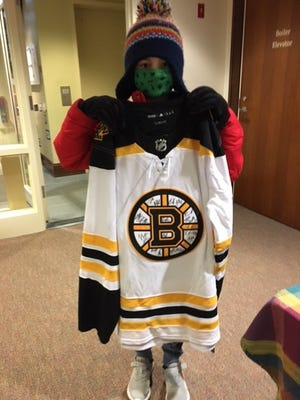 Finn Poulos won a Boston Bruins prize for his outstanding participation in the Mattapoisett Free Public Library's summer reading program.