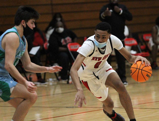 Dramond Bryant looks for an opening against Rose during Friday night's basketball game at New Bern.