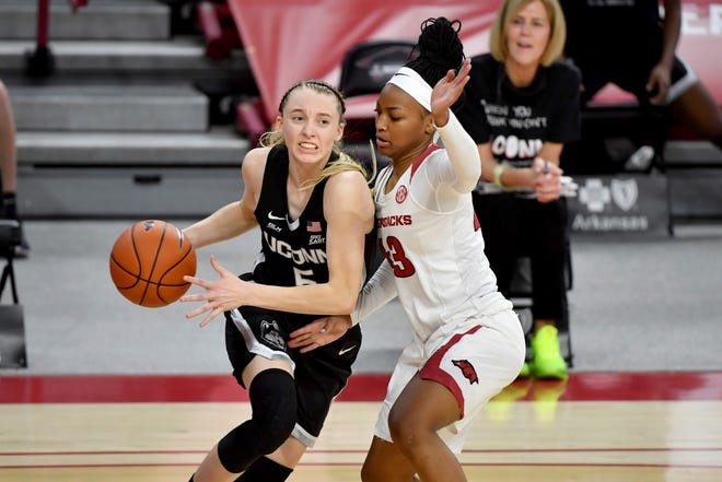 Connecticut guard Paige Bueckers (5) drives Arkansas defender Makayla Daniels (43) during the second half of an NCAA college basketball game Thursday, Jan. 28, 2021, in Fayetteville, Ark.