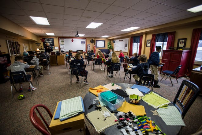 With desks distanced apart, fifth graders take a test Thursday morning at Cair Paravel Latin School. The school has had continuous five-day-a-week, in-person learning since the start of the school year.