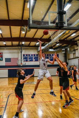 Cair Paravel's Noah Hastert goes up for a shot against Lyndon during Friday's game at Cair Paravel. The Lions didn't have enough for the No. 7-ranked Tigers, falling 71-41.