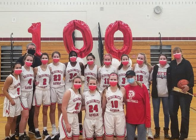 Bridgewater-Raynham girls head coach Cheryl Seavey, far right, stands with her team after the Trojans beat Brockton at Monti gymnasium on Friday.