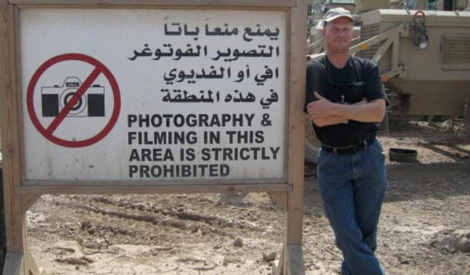 In this undated photo Mark Frerichs, a contractor from Illinois, poses in Iraq .