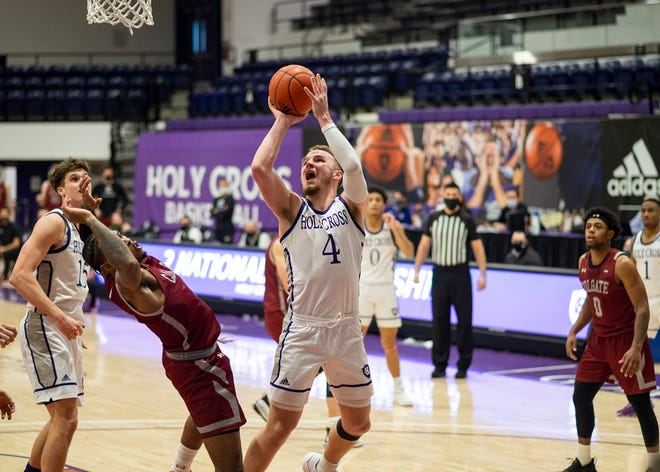 Holy Cross' Austin Butler takes a shot during the game against Colgate on Saturday, January 30, 2021.