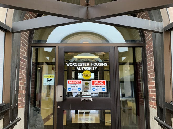 Signs alert residents that they must wear a mask at the Worcester Housing Authority building on Belmont Street.
