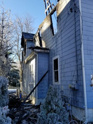 Fire damage to the side and rear second floor of 16 Auclair St. in Blackstone on Saturday.