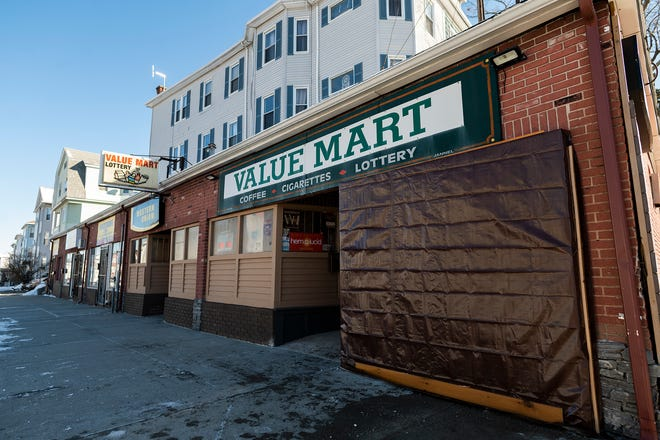 A window at Value Mart on Hamilton Street is boarded up after the building was damaged in a car crash early Saturday morning.