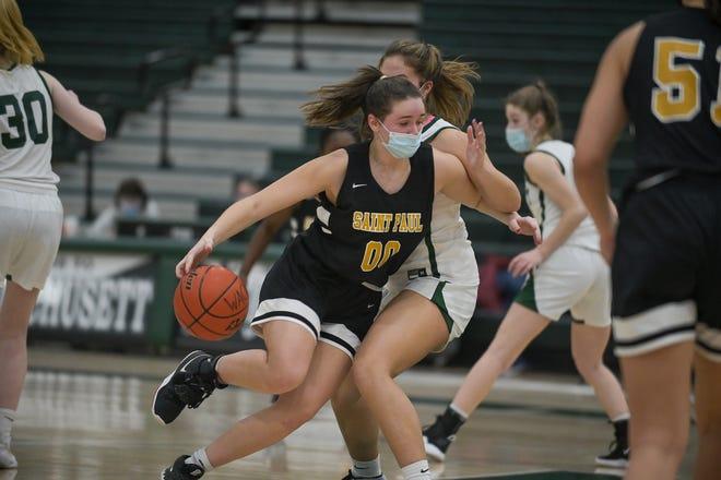 St. Paul's Lindsey Krysinski takes a drive to the basket against Wachusett defenders.