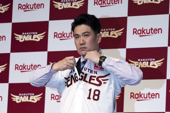 Masahiro Tanaka dons the jersey of his former Japanese team, which he has rejoined for the next two seasons.