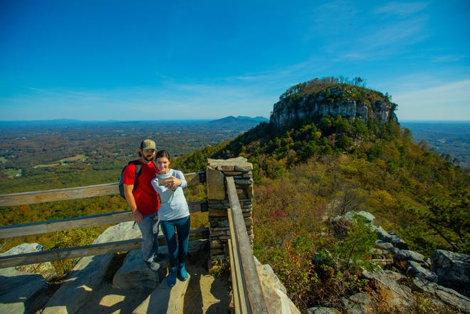 A couple takes a selfie photo at Pilot Mountain, North Carolina
