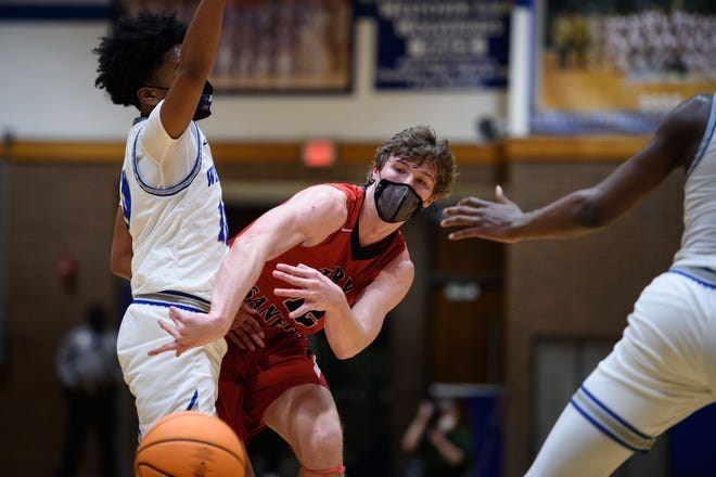 The Terry Sanford boys' basketball team, led by Davis Molnar (12), will carry a top seed into the NCHSAA state playoffs. The Bulldogs are aiming to make a run at their first state title since 2015.