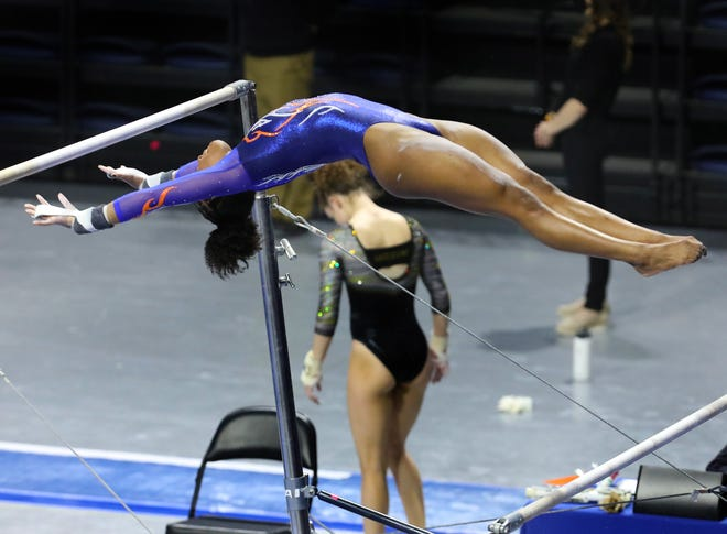 Florida gymnast Trinity Thomas performs her routine on the bars Friday against Missouri at Exactech Arena. The Gators beat the Tigers.