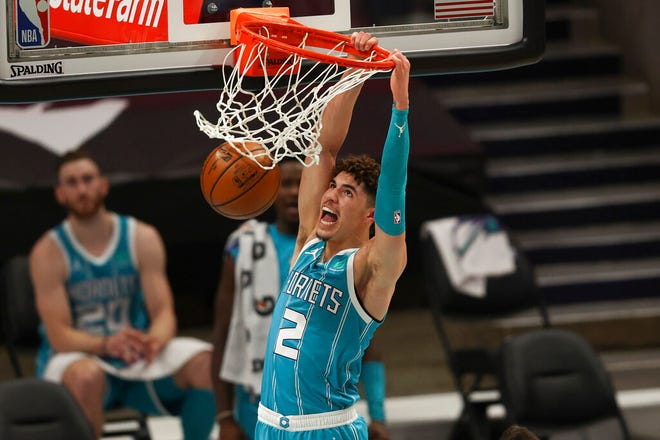 Charlotte Hornets guard LaMelo Ball dunks against the Indiana Pacers during the first half of an NBA basketball game in Charlotte, N.C., Friday, Jan. 29, 2021. (AP Photo/Nell Redmond)