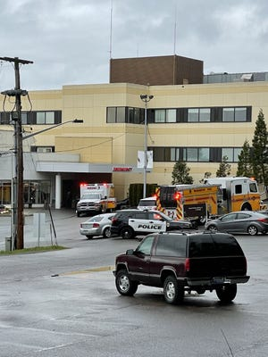 Bremerton police and Bremerton Fire vehicles park at St. Michael Medical Center in Bremerton Saturday, where a 16-year-old girl was flown to Harborview Medical Center in Seattle with a stab wound.
