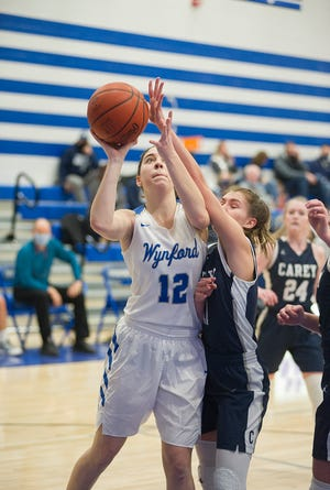 Wynford's Averi McMillan powers up a shot over Carey's Alaina Tiell.
