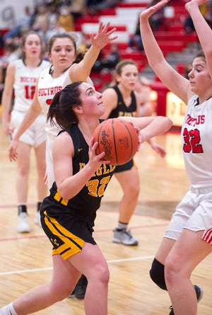 Colonel Crawford's Kaylyn Risner looks to shoot over Bucyrus' Lilly Neumann.